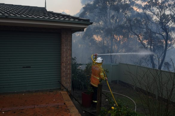 A NSW Rural Fire Service personnel conducts property protection as a bushfire burns in Woodford NSW, Australia, November 8, 2019. AAP Image/Dan Himbrechts/via REUTERS